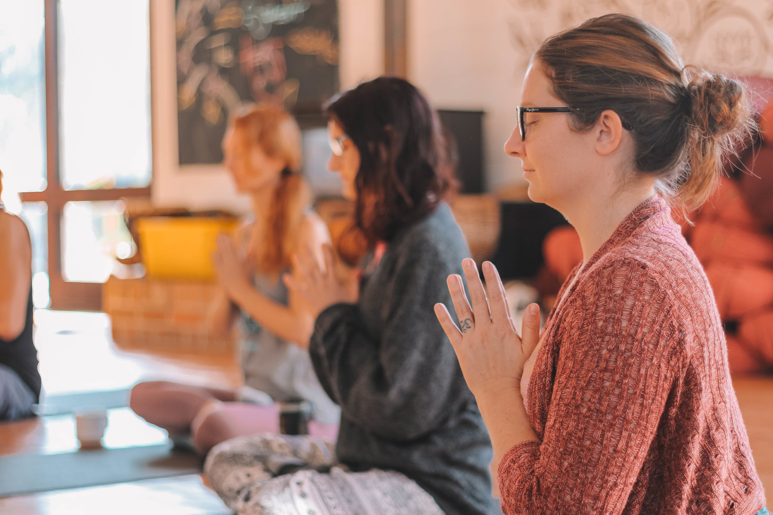 Showing meditating people immersed in yoga